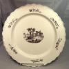 "Wedgwood creamware 15"" charger decorated with a puce transferware of ancient ruins."