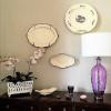 For a Summit, NJ home the wall is adorned with 3 pieces of English creamware accompanied by a French lavender crystal lamp.